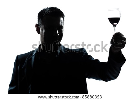 one caucasian man portrait silhouette rising up toasting his glass of red wine in studio isolated white background - stock photo