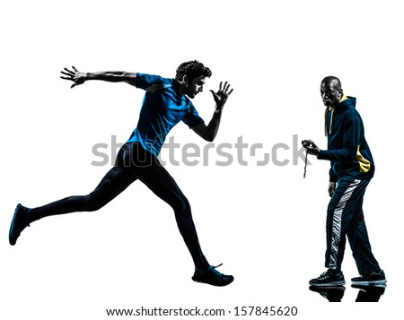 one caucasian man  running sprinting with coach stopwatch in silhouette studio isolated on white background - stock photo