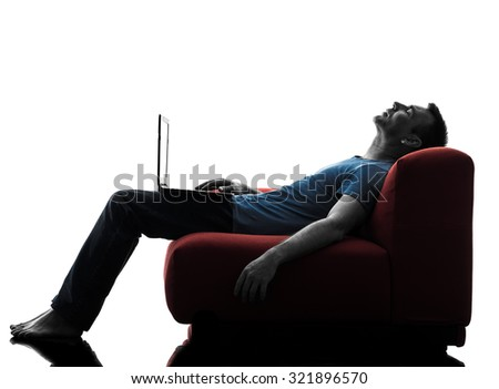 one caucasian man sofa couch computer computing laptop sleeping in silhouette isolated on white background - stock photo