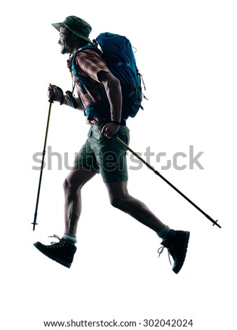 one caucasian man trekker trekking running happy  in silhouette isolated on white background - stock photo