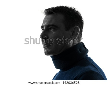 one caucasian man with cervical collar neckache  portrait in silhouette studio isolated on white background - stock photo