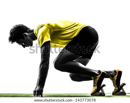 one caucasian man young sprinter runner  in starting blocks  silhouette studio  on white background - stock photo