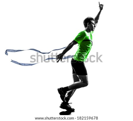 one caucasian man young sprinter runner running winner at finish line in silhouette studio on white background - stock photo