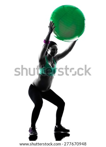 one caucasian pregnant woman exercising fitness exercises  in silhouette studio isolated on white background - stock photo