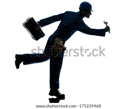 one caucasian repairman worker running urgency silhouette in studio on white background