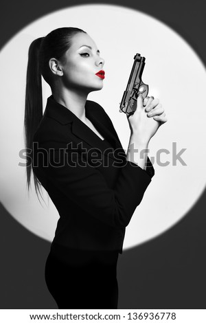 one caucasian sexy detective woman holding aiming gun - stock photo