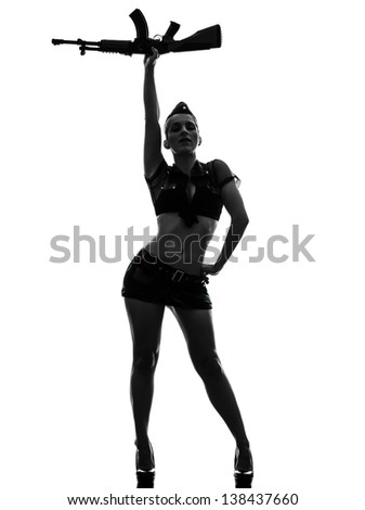 one caucasian sexy woman in army uniform saluting with kalachnikov in silhouette studio isolated on white background - stock photo