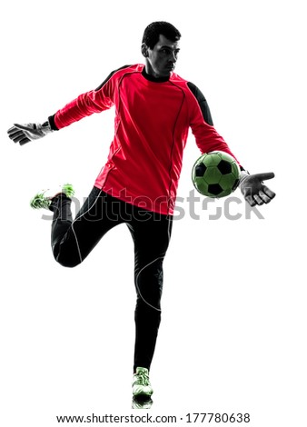 one caucasian soccer player goalkeeper man kicking ball in silhouette isolated white background - stock photo