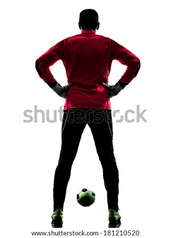 one caucasian soccer player goalkeeper man standing rear view in silhouette isolated white background - stock photo