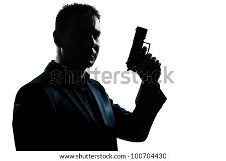 one caucasian spy criminal policeman detective man holding gun portrait silhouette in studio isolated white background - stock photo