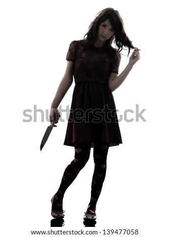 one caucasian strange young woman killer holding  bloody knife in silhouette white background - stock photo