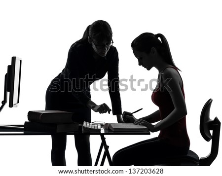 one caucasian teacher woman mother teenager girl studying  in silhouette studio isolated on white background - stock photo