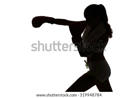 one caucasian woman boxing exercising in silhouette studio isolated on white background - stock photo