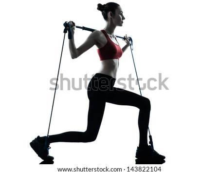 one caucasian woman exercising elastic gymstick in silhouette studio isolated on white background - stock photo