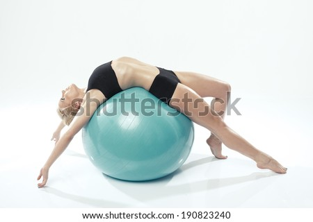 one caucasian woman exercising fitness ball workout - stock photo