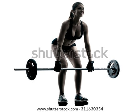 one caucasian woman exercising fitness body building exercises in studio in silhouette isolated - stock photo