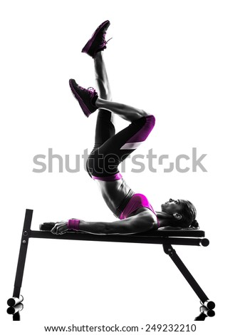 one caucasian woman exercising  fitness in studio silhouette isolated on white background - stock photo
