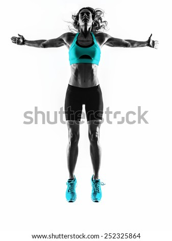 one caucasian woman exercising  fitness  jumping  stretching  in studio silhouette isolated on white background - stock photo