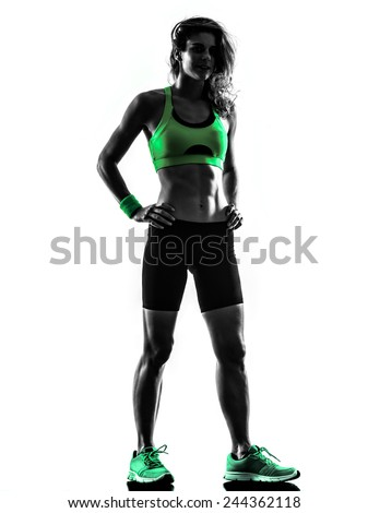 one caucasian woman exercising  fitness standing  in studio silhouette isolated on white background - stock photo