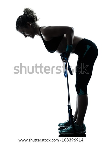 one caucasian woman exercising gymstick  fitness workout posture in silhouette studio isolated on white background - stock photo