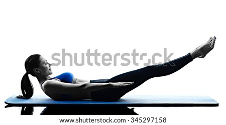 one caucasian woman exercising pilates exercises fitness in silhouette isolated on white backgound - stock photo