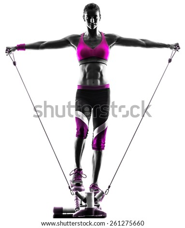 one caucasian woman exercising stepper resistance bands fitness in studio silhouette isolated on white background - stock photo