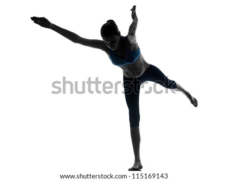 one caucasian woman exercising yoga standing on one leg in silhouette studio isolated on white background
