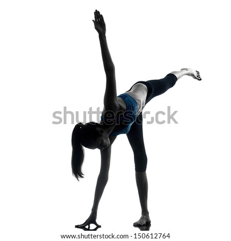 one caucasian woman exercising yoga standing on one leg in silhouette studio isolated on white background - stock photo