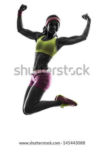 one caucasian woman jumping arms raised  in silhouette on white background - stock photo