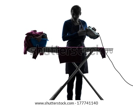 one caucasian woman maid cleaning ironing in silhouette studio isolated on white background
