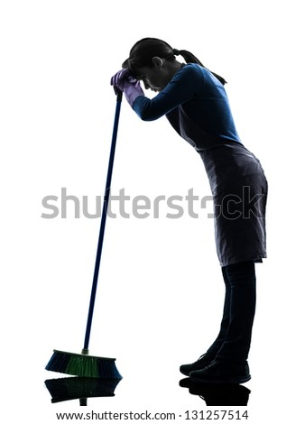 one caucasian woman maid cleaning tired brooming   in silhouette studio isolated on white background - stock photo