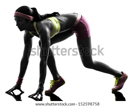 one caucasian woman runner running  on starting blocks  in silhouette on white background - stock photo