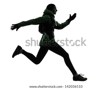 one caucasian woman runner running trekking  in silhouette studio isolated on white background - stock photo