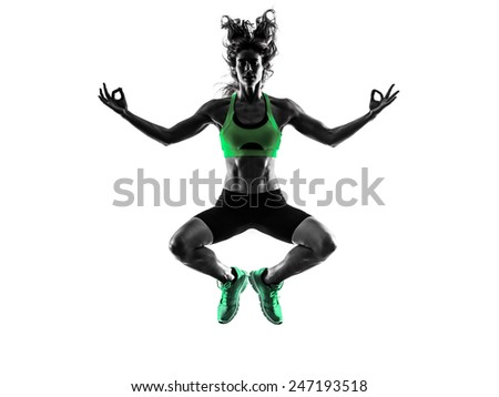 one caucasian woman serene zen   exercising  fitness jumping in studio silhouette isolated on white background - stock photo