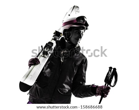 one caucasian woman skier skiing in silhouette on white background