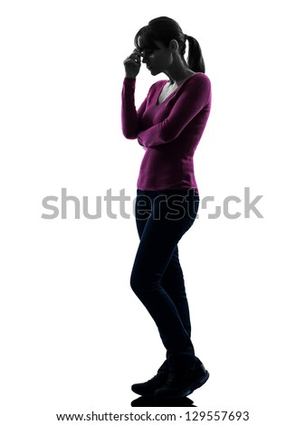 one caucasian woman thinking sadness in full length silhouette studio isolated on white background