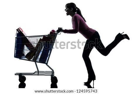 one caucasian woman with full shopping cart in silhouette studio isolated on white background