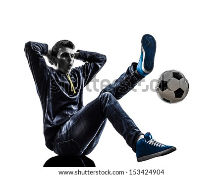 one caucasian young man soccer freestyler player  in silhouette  on white background - stock photo