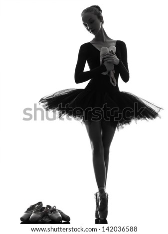 one caucasian young woman ballerina ballet dancer dancing with tutu in silhouette studio on white background - stock photo