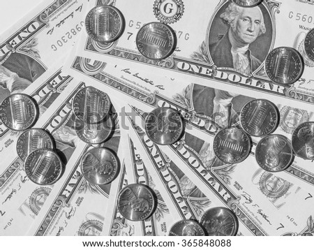 One cent coins and One Dollar banknotes  currency of the United States useful as a background in black and white
