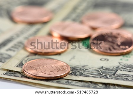 one cent coins on us dollar currency. Macro shot