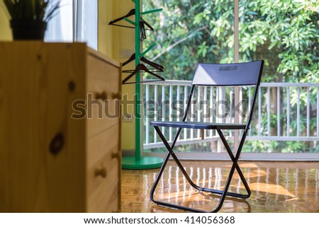 One chair by the window