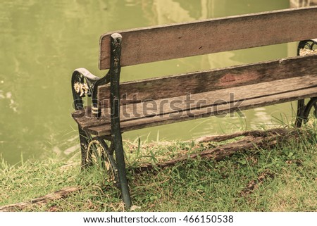 One chair near the river.