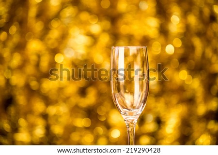 One champagne glass on christmas bokeh background