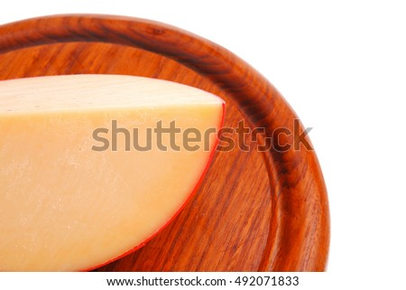 one cheese piece on wooden plate over white