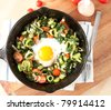 One Chicken Egg Cooked in Middle of Sauteed Vegetables - stock photo