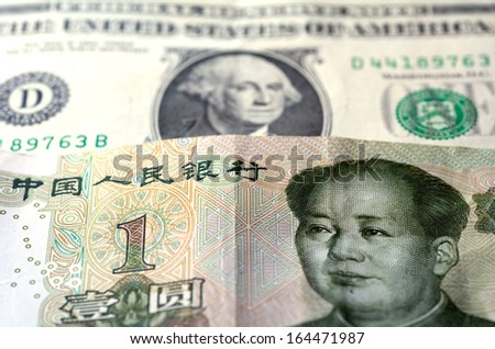 One Chinese Yuan bill (Mao Zedong) on one American Dollar money (George Washington.Concept photo of economy currency strategy growth,corporate assets,national debt and debtor and world power leaders.