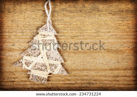 One Christmas baubles in shape of Christmas tree on wooden background    - stock photo