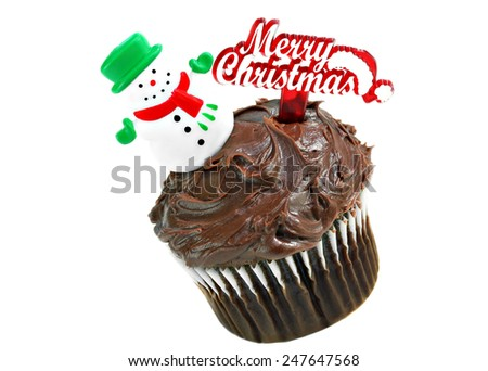 One Christmas chocolate cupcake with a snowman on top and Merry Christmas. White background with copy space. - stock photo