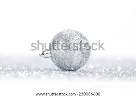One chritmas ball on glitters isolated on white background - stock photo